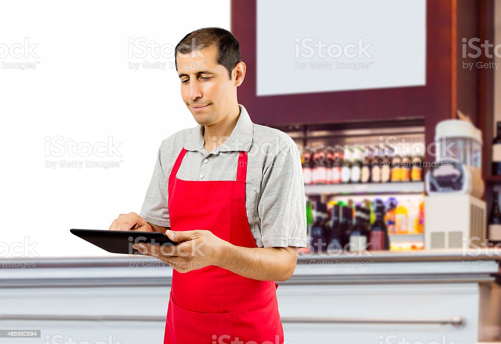 assistant working at the cafe with tablet stock photo