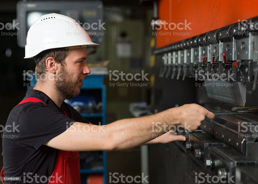 assisting an industrial machinery stock photo