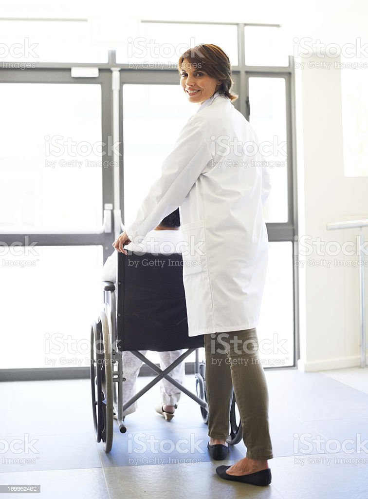Assisting her patient royalty-free stock photo