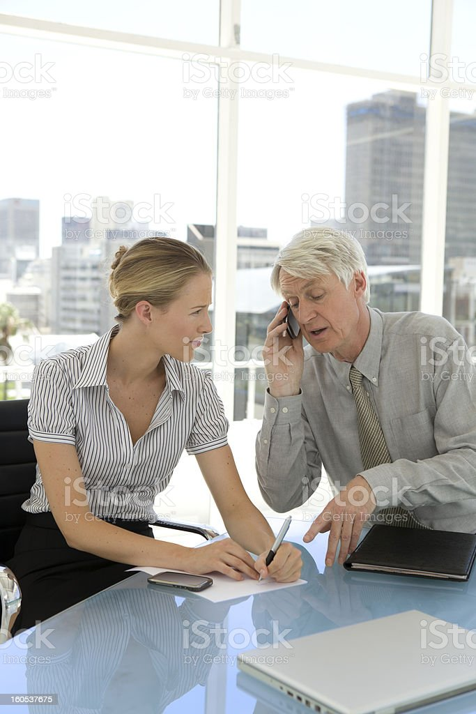 Assisting the CEO royalty-free stock photo