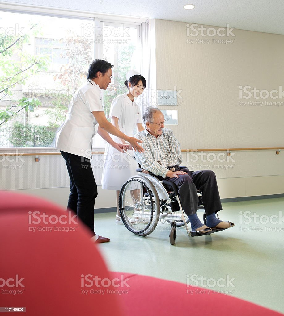 Assisting the patient stock photo