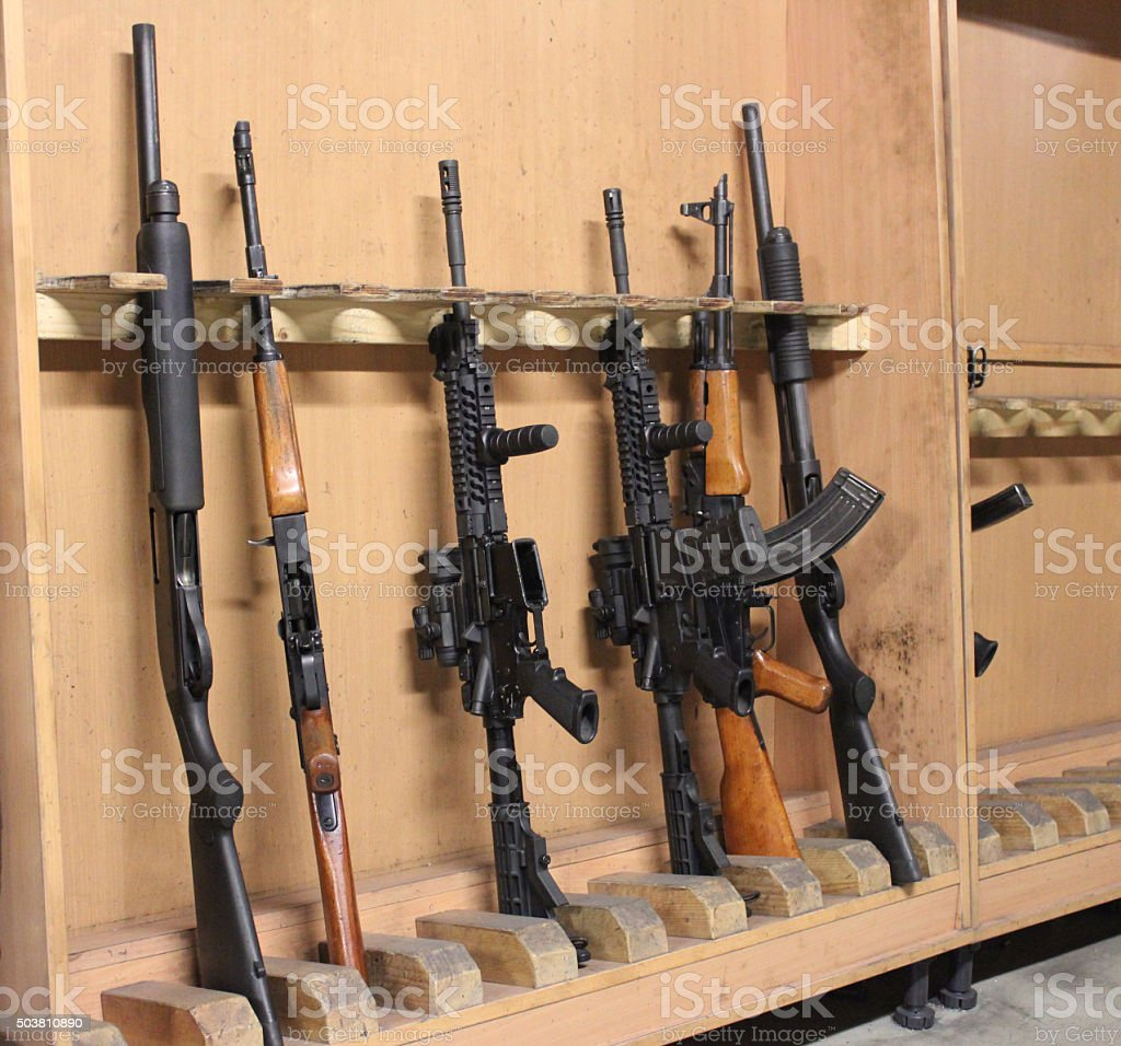 Assorted automatic rifles and guns stock photo