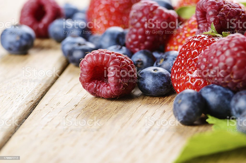 Assorted berries on the table stock photo