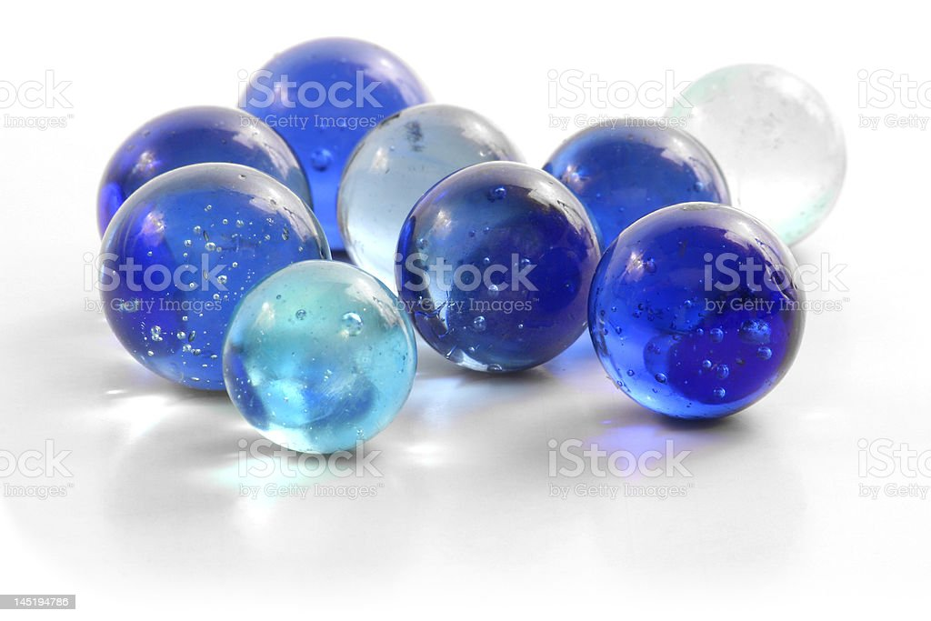 Assorted Blue Marbles on White royalty-free stock photo