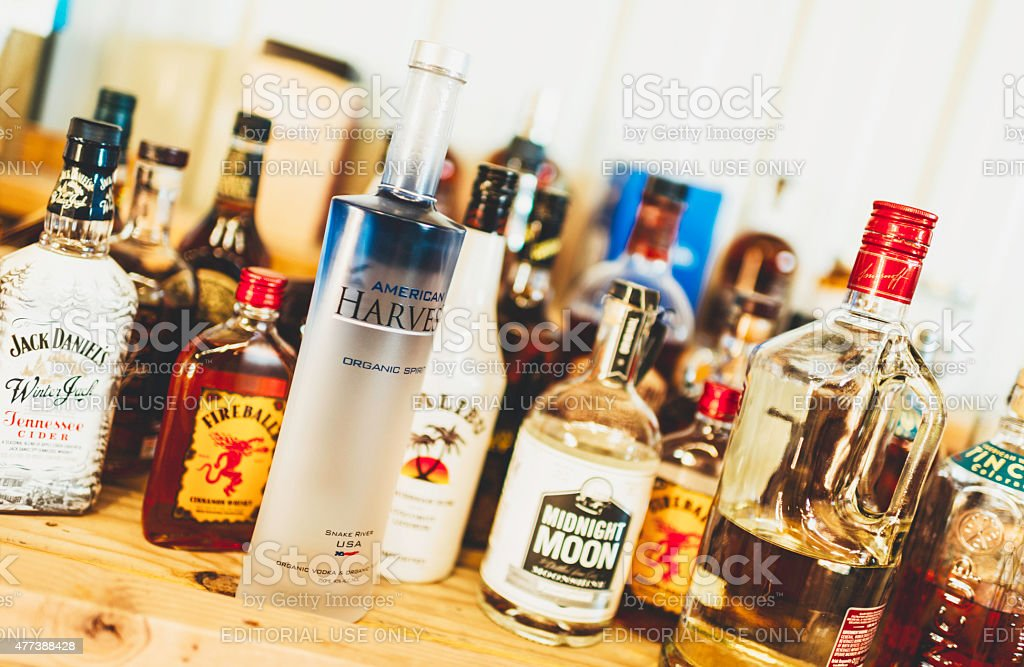 Assorted bottles of alcohol stock photo