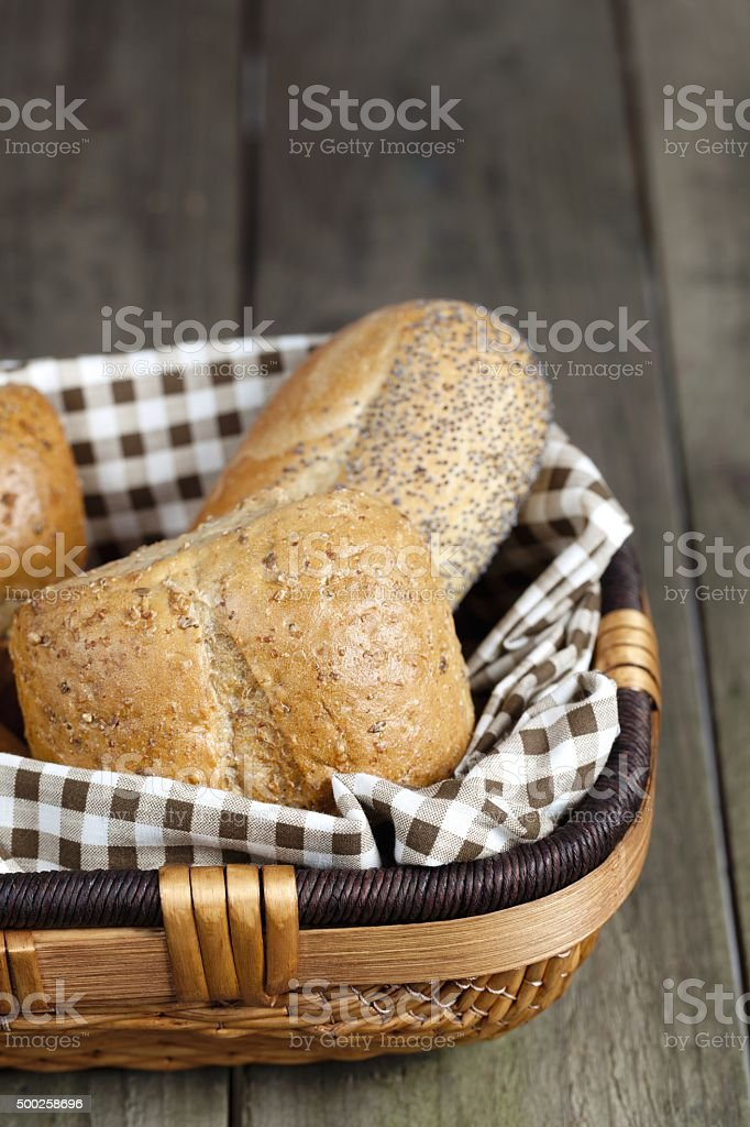 assorted bread in basket stock photo