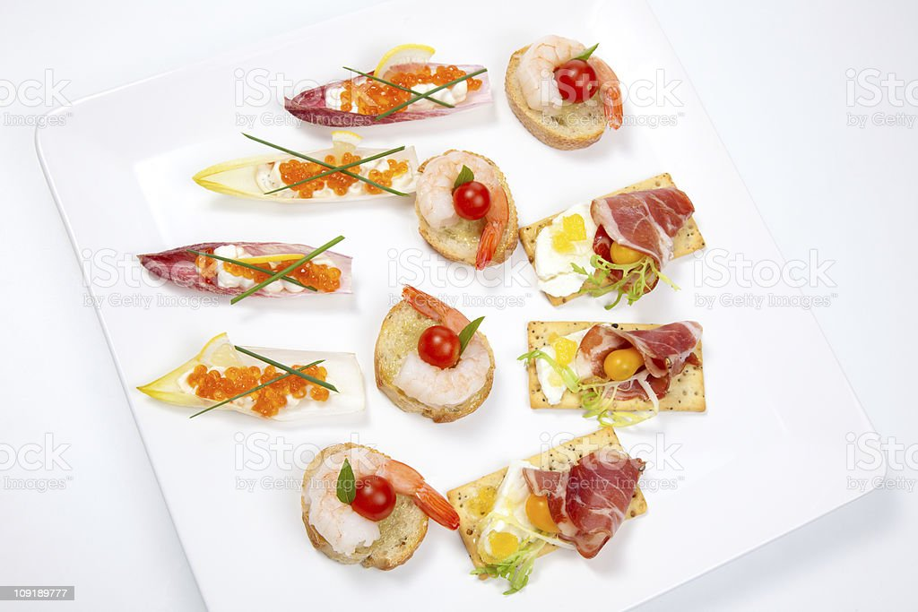 Assorted canapes on tray royalty-free stock photo