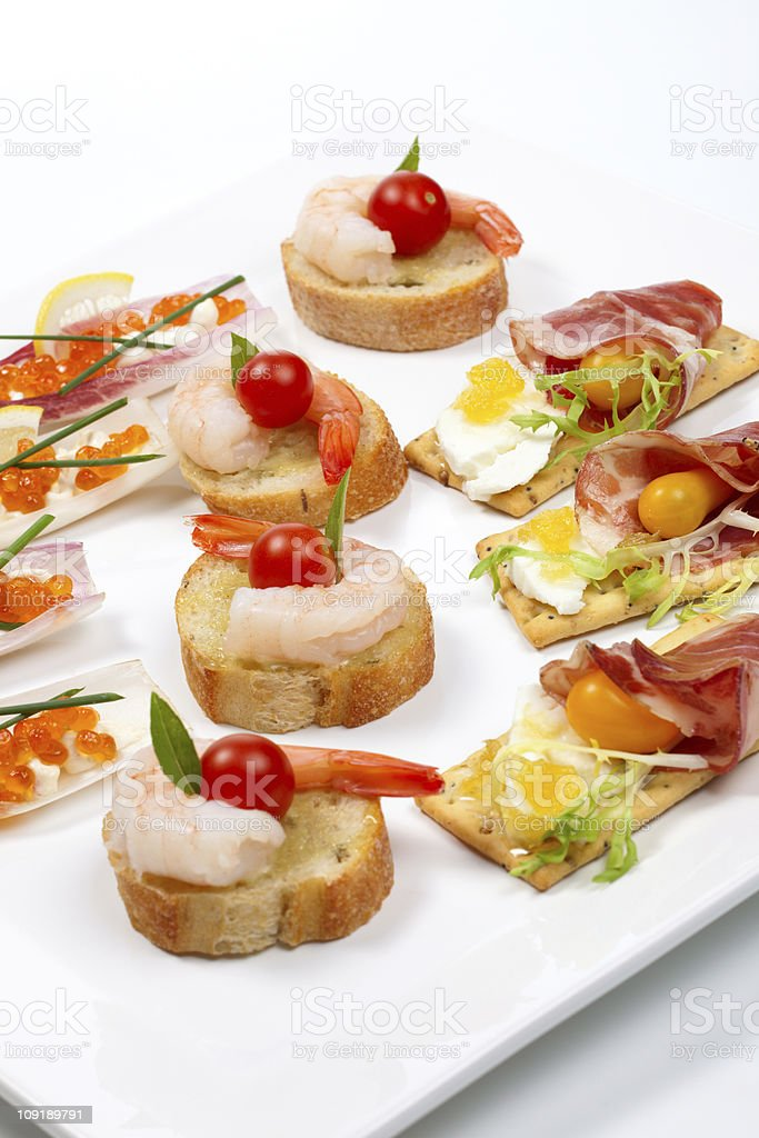 Assorted canapes on tray stock photo