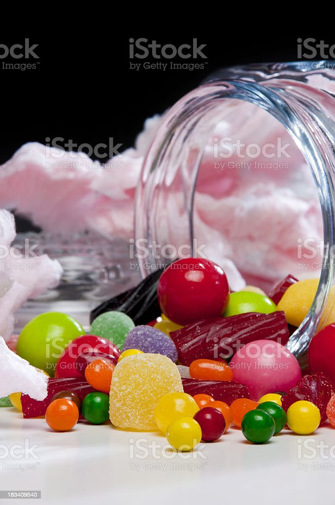 Assorted candy spilling from jar royalty-free stock photo