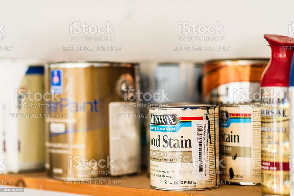 Assorted cans of paint, spray paint and wood stain. stock photo