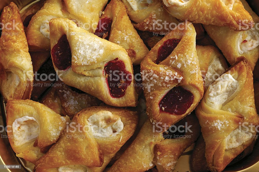 Assorted cheese and raspberry pastry bites royalty-free stock photo