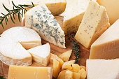 Assorted cheese on wooden platter