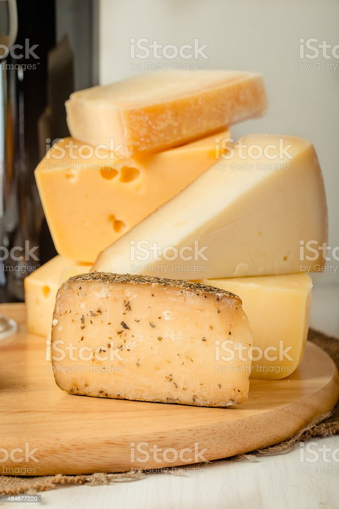 Assorted Cheese Plate with Red Wine, Nuts and Honey stock photo