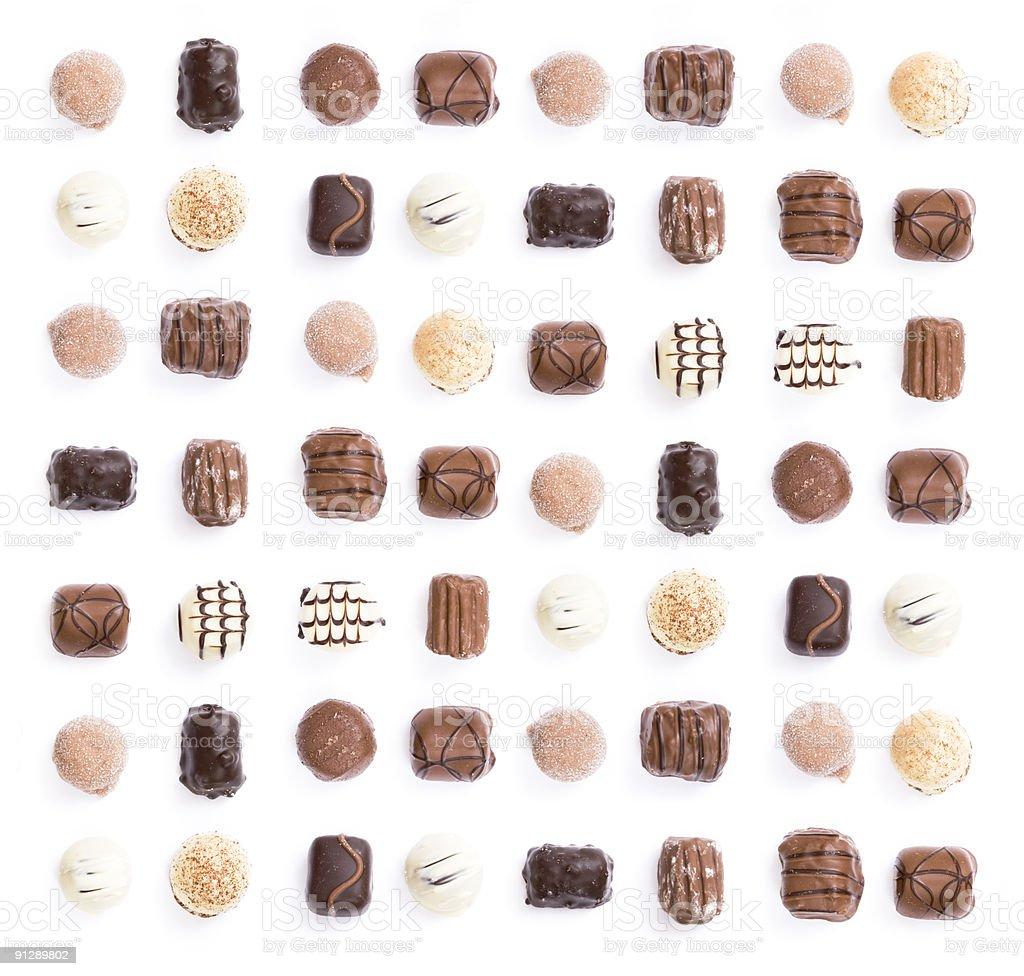 Assorted chocolate truffles on white background stock photo