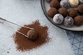 Assorted chocolate truffles with cocoa powder