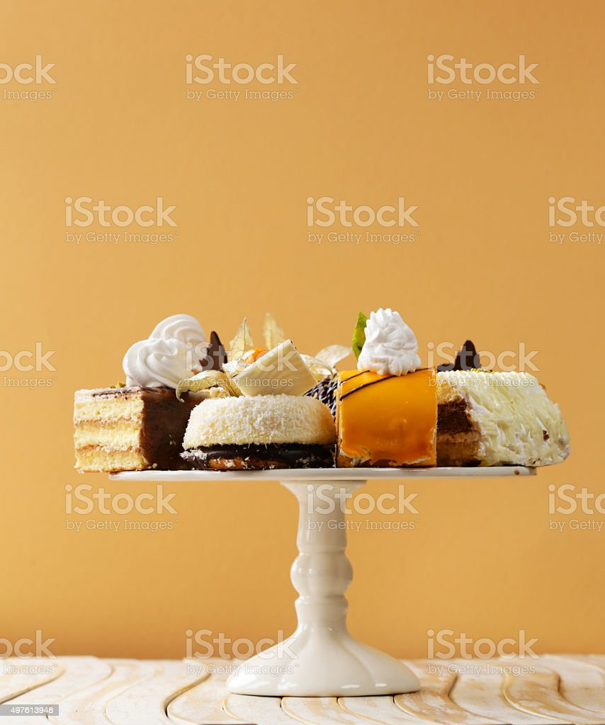 Assorted different mini cakes with cream, chocolate and berries stock photo