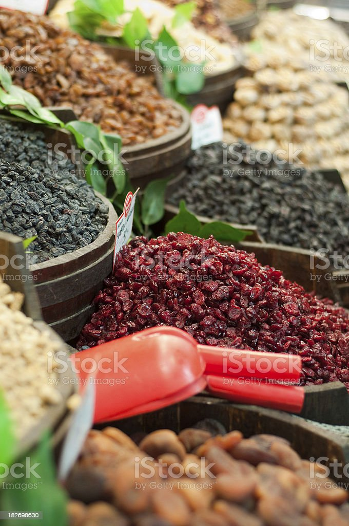 Assorted dried fruit at a market stock photo