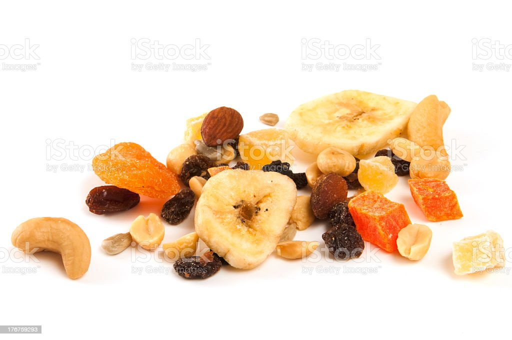 Assorted dried fruits and nuts on a white background stock photo