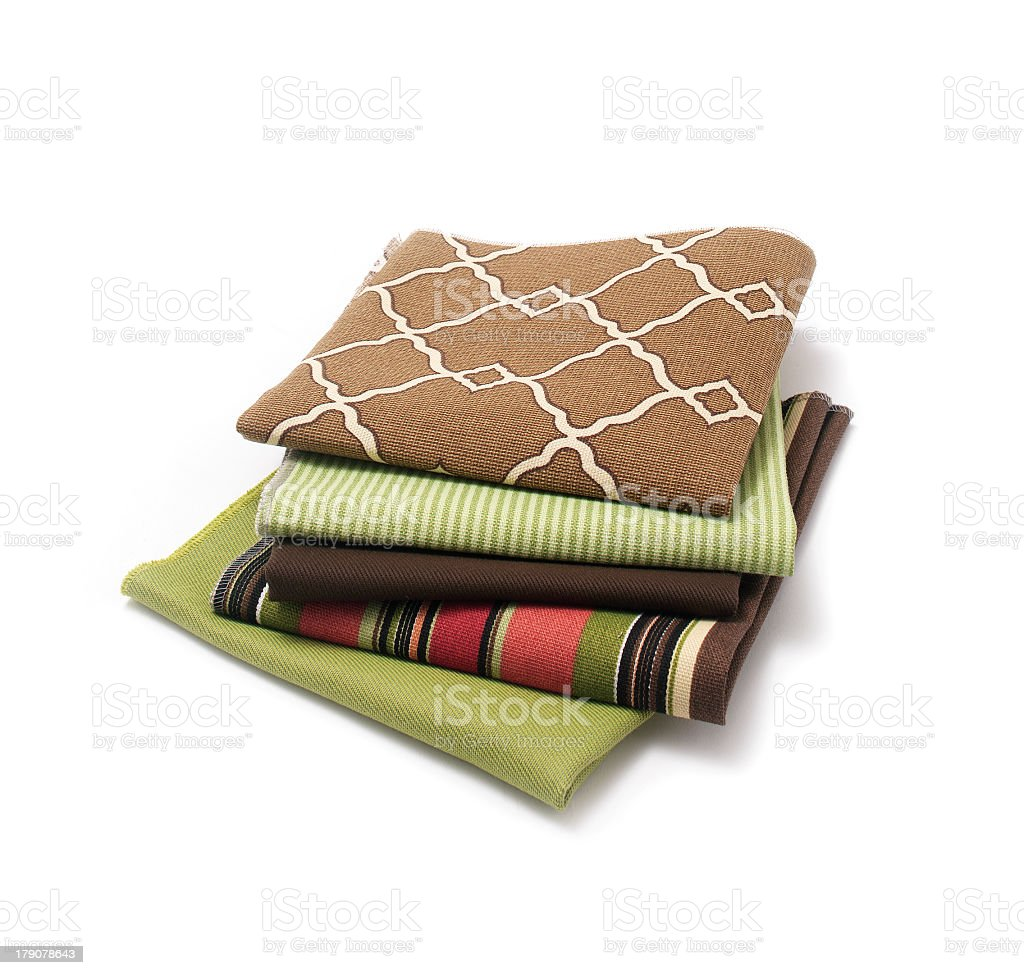 Assorted fabrics in various colors and patterns royalty-free stock photo
