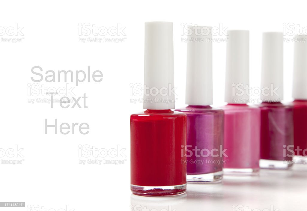 Assorted fingernail polish on a white background with copy space royalty-free stock photo