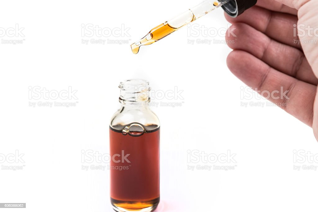 Assorted flavors vape juice and eyedropper being used stock photo