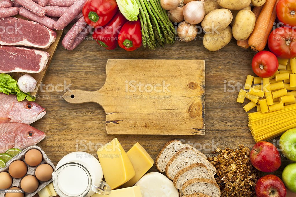 Assorted food border on wood table shot from above stock photo
