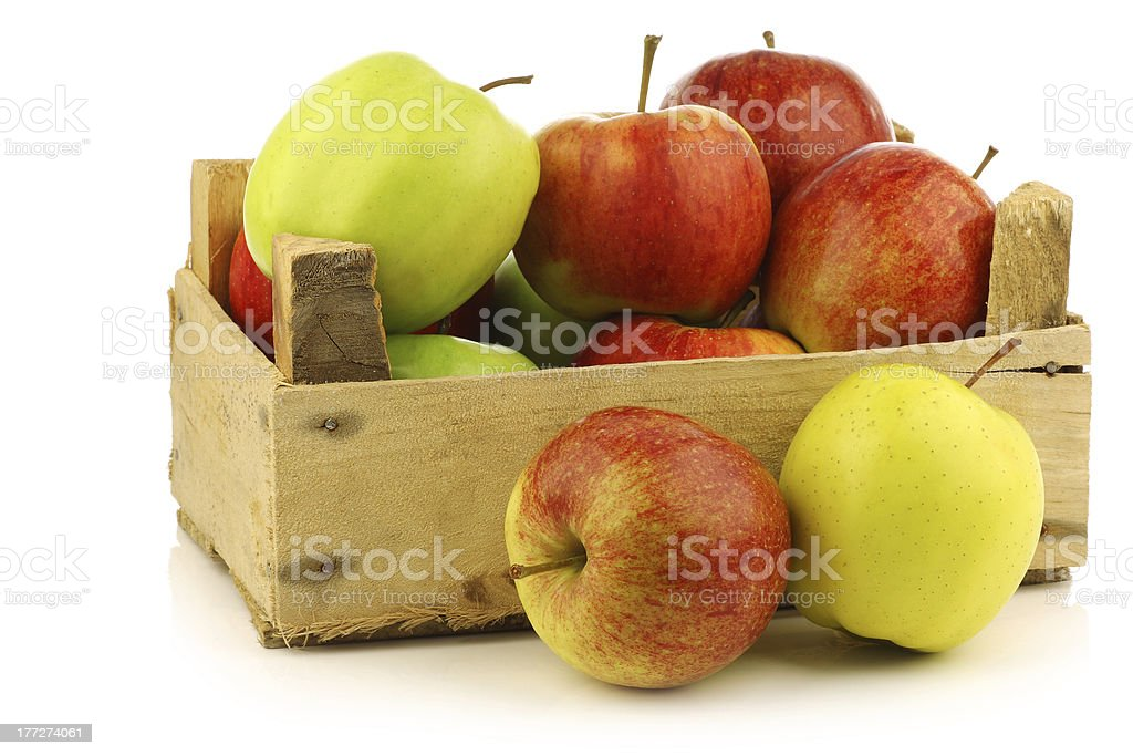 assorted fresh apples in a wooden crate royalty-free stock photo