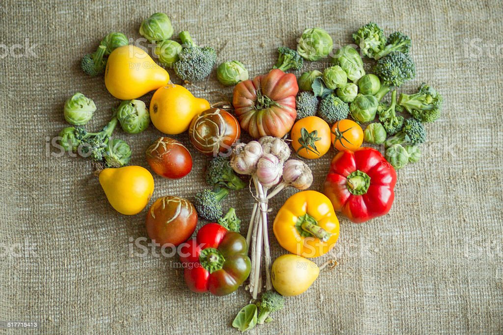 Assorted fresh vegetables and pears in the shape of heart stock photo