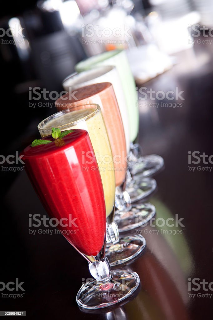 Assorted fruit and berry smoothies on the bar stock photo