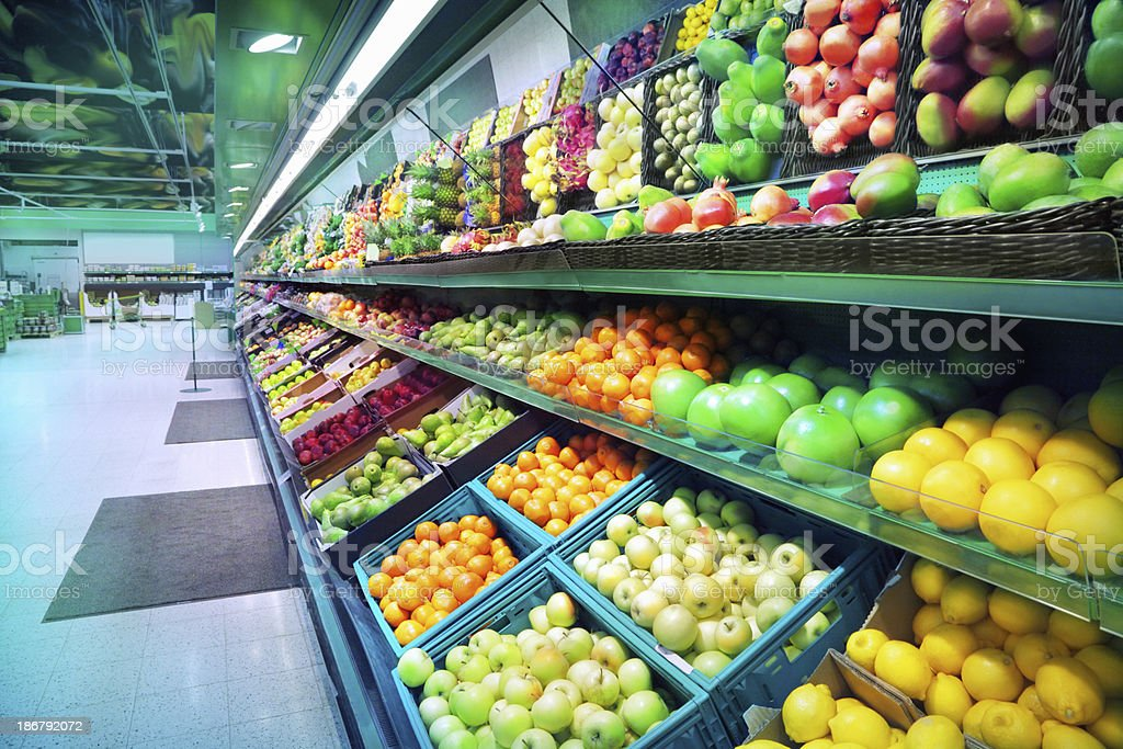 Assorted fruits in modern fruit market stock photo