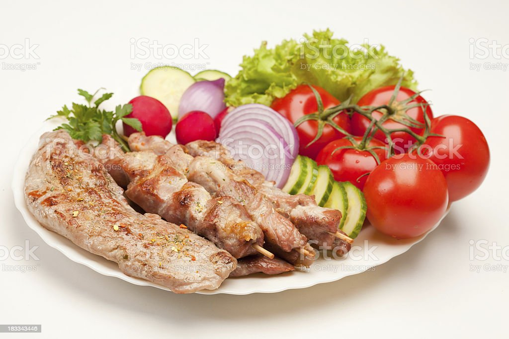 Assorted grilled meat with vegetables royalty-free stock photo