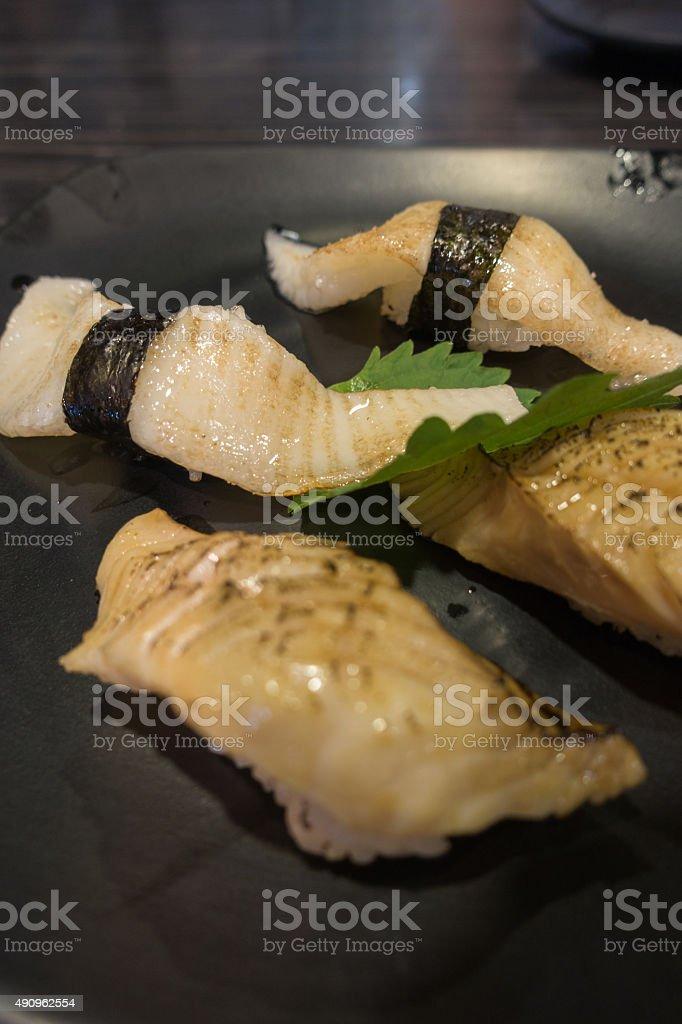 Assorted Japanese Sushi on black ceramic plate stock photo
