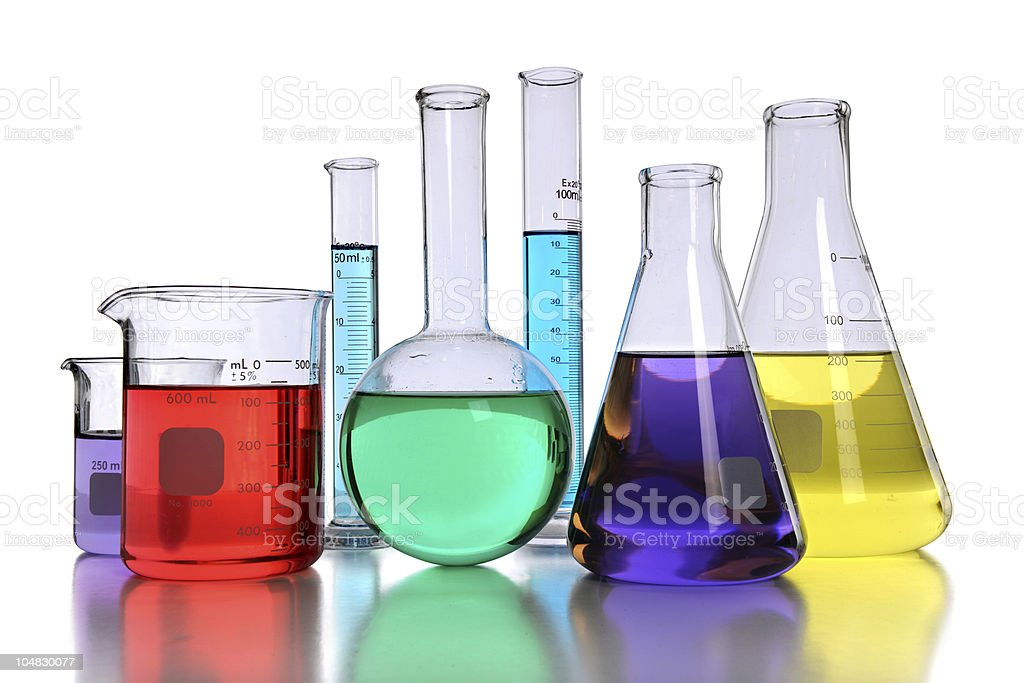 Assorted laboratory glassware filled with colored liquids stock photo