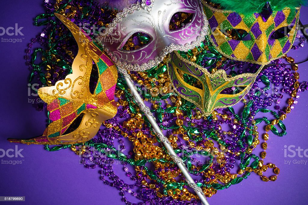 Assorted Mardi Gras or Carnivale mask on a purple background stock photo