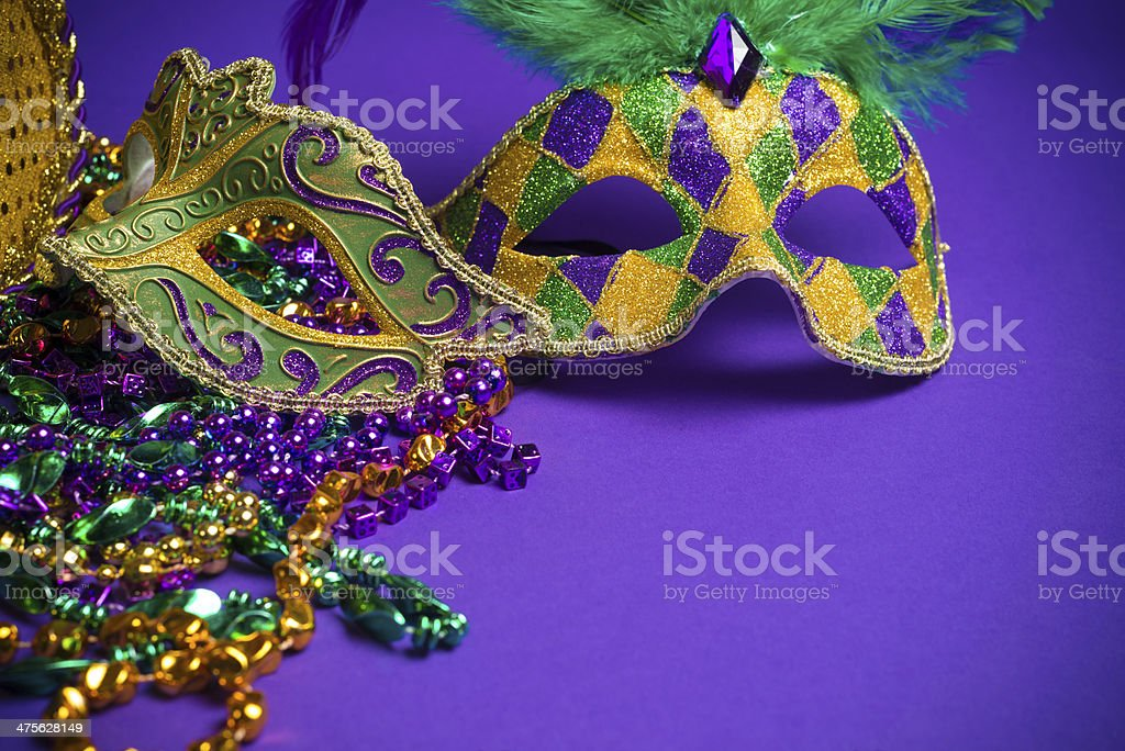 Assorted Mardi Gras or Carnivale masks on a purple background stock photo