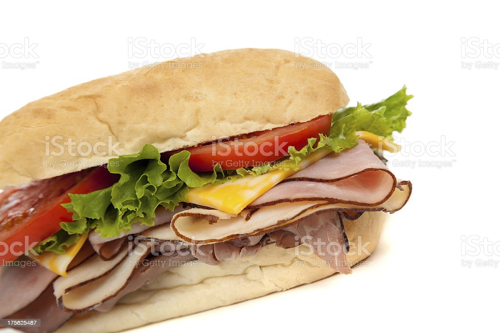 Assorted meat sandwich with fixings on a hoagie royalty-free stock photo