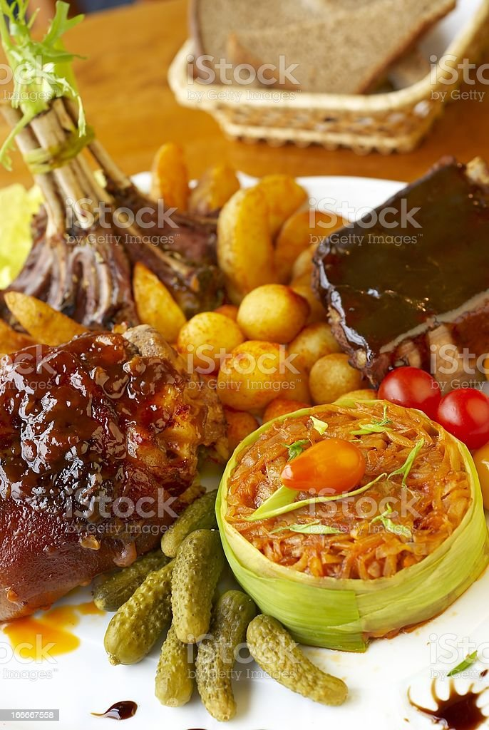 Assorted meat with vegetables garnish royalty-free stock photo