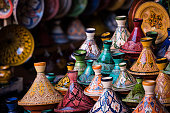 Assorted Moroccan tajines in a souk