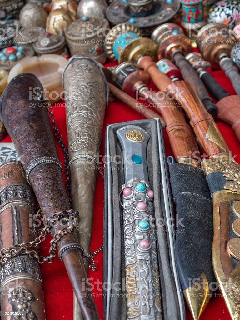 Assorted Nepalese Souvenirs, khukuri and prayer wheels stock photo