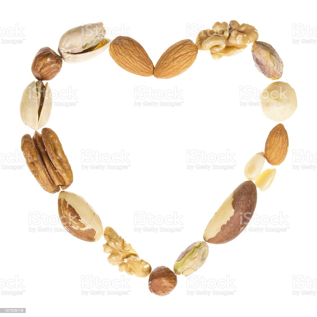 Assorted nuts heart frame stock photo