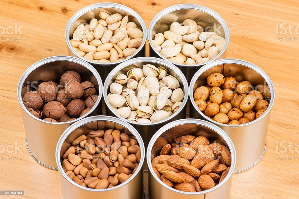 Assorted nuts in Iron pot pecan stock photo