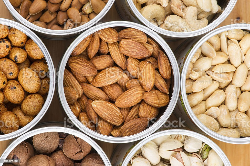 Assorted nuts in Iron pot royalty-free stock photo