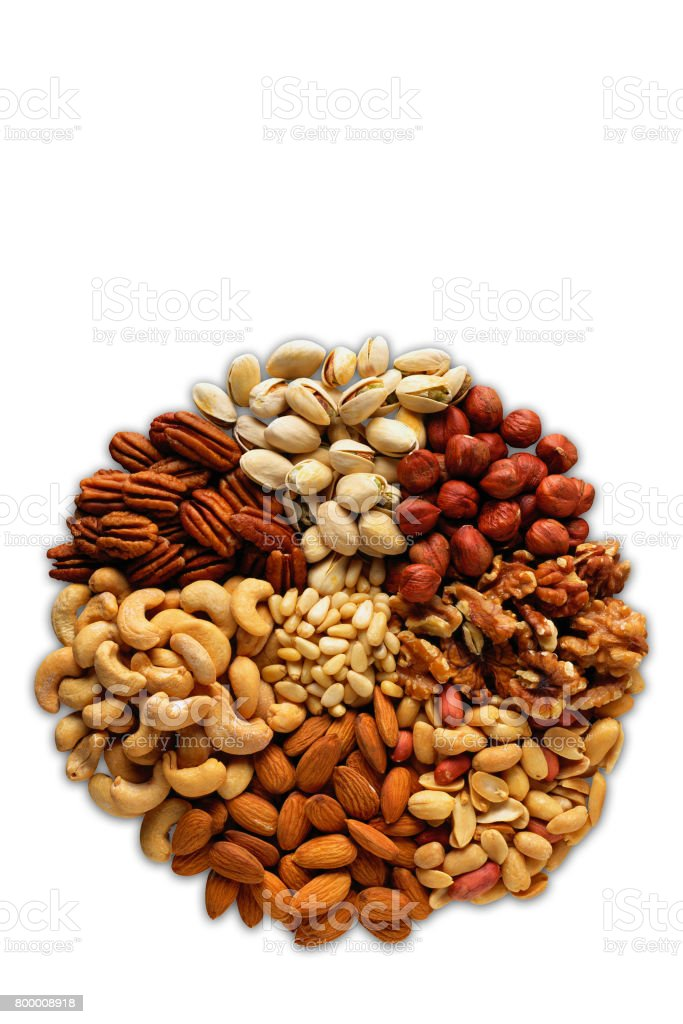 Assorted nuts in the form of a circle (peanuts, almonds, hazelnuts, pine nuts, cashews, walnuts, pistachio) on a white background stock photo