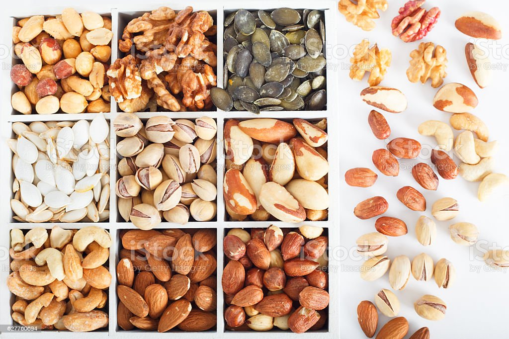 Assorted nuts in wooden box stock photo