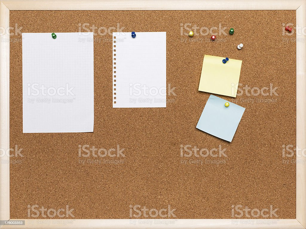 Assorted papers on cork board royalty-free stock photo