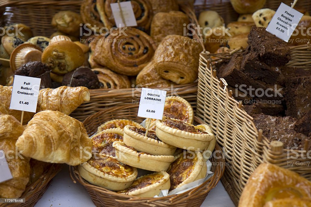 assorted pastries for sale displayed in wicker baskets stock photo