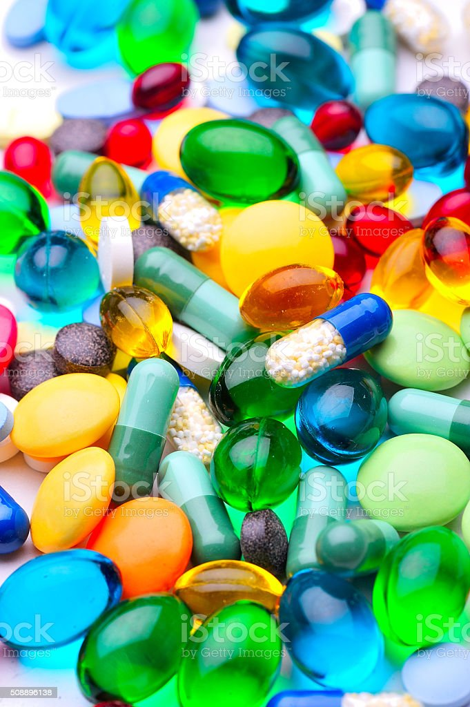 assorted pharmaceutical capsules and medication stock photo