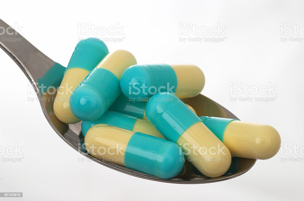 assorted pills in spoon royalty-free stock photo