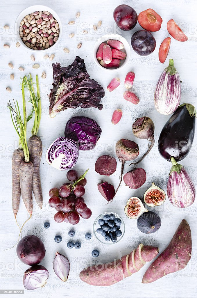 Assorted purple toned fruits and vegetables as a collection stock photo