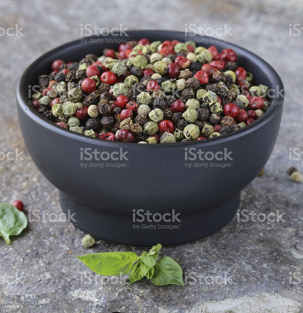 assorted red, black and green pepper in a bowl royalty-free stock photo